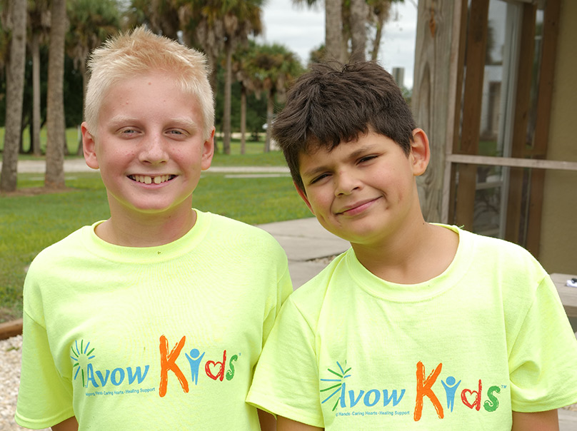 Two kids wearing Avow kids shirts